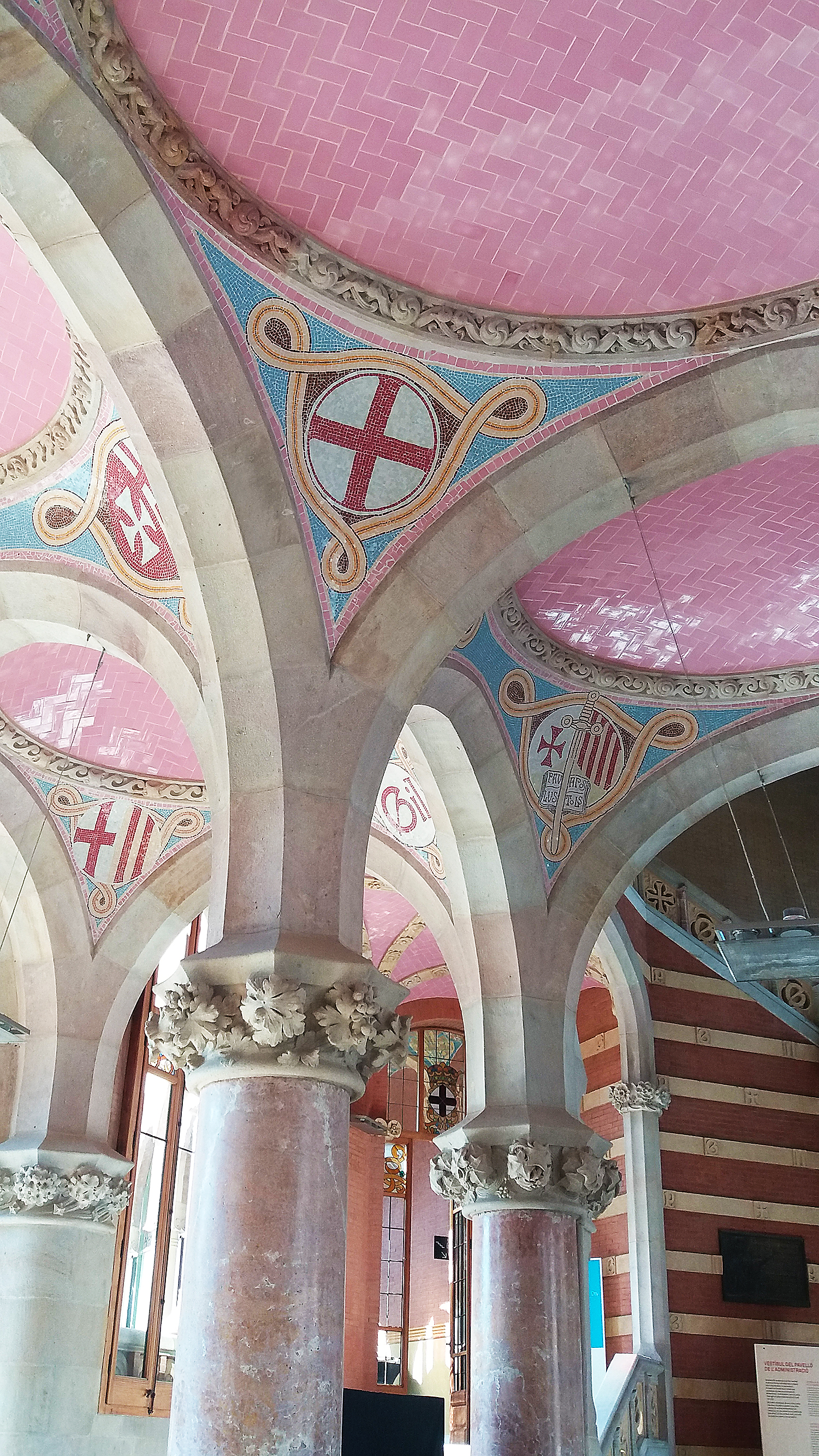 Pink marble ceiling and stone pelars. Photo.