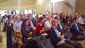 Audience, all looking in the same direction. Photo.