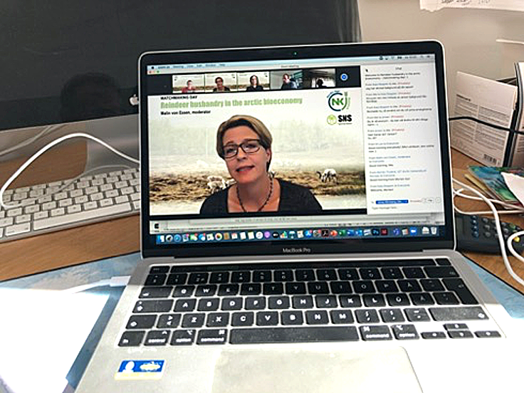 Laptop showing a digital meeting with woman in center. Photo.
