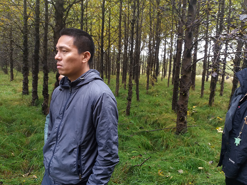 Man outside in forest. Photo.